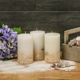 Candela Ocean profumata all' Essenza Ivory con conchiglie all'interno